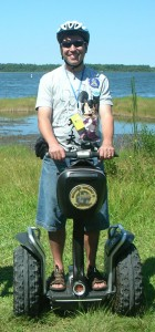 The Mouse Planner rides a Segway at Disney's Fort Wilderness