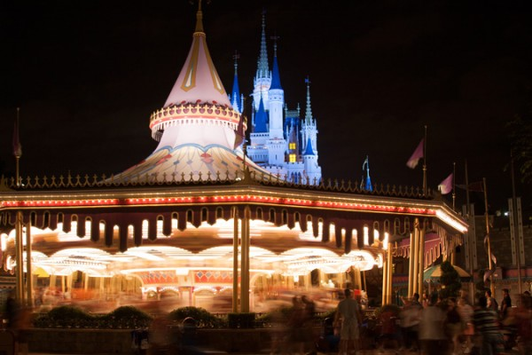 Prince Charming Regal Carrousel and Cinderella Castle at night