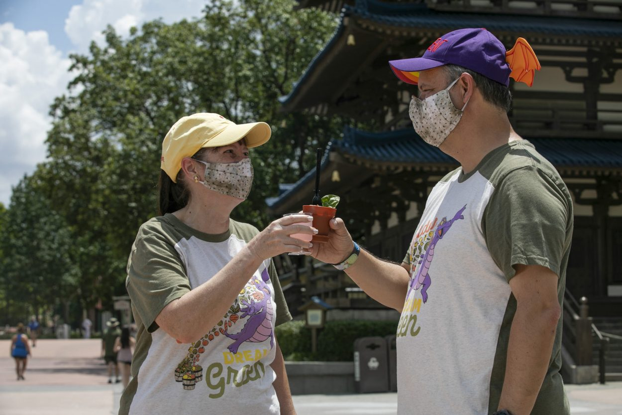 Masked Guests toast the Epcot International Food & Wine Festival